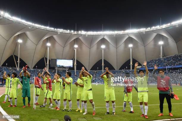 Urawa Red Diamonds players applaud after the 11 draw in the AFC Champions League Final 2017 first leg between AlHilal and Urawa Red Diamonds at King...
