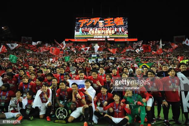 Urawa Red Diamonds players applaud supporters after their 10 victory and becoming the Asian Champions after the AFC Champions League Final second leg...