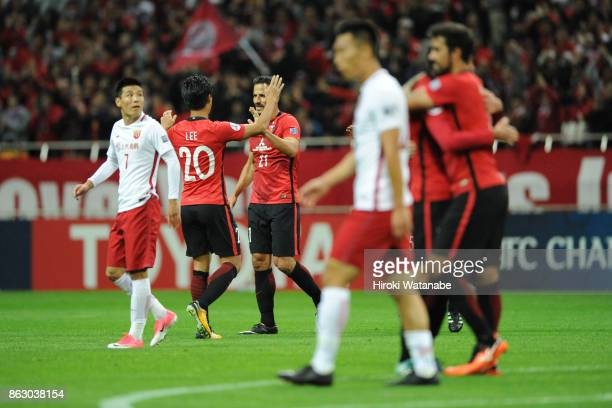 Urawa Red Diamonds Players celebrate after their team's 10 win in the AFC Champions League semi final second leg match between Urawa Red Diamonds and...