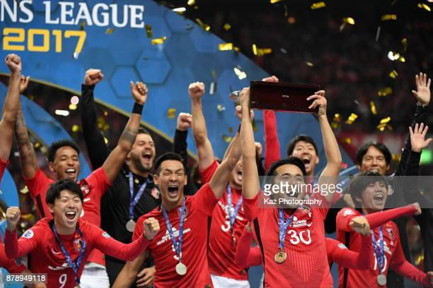 Urawa Red Diamonds players celebrate at the award ceremony during the AFC Champions League Final second leg match between Urawa Red Diamonds and...
