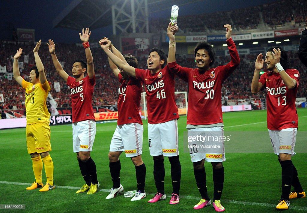 Urawa Red Diamonds players celebrate the win after the J.League match between Urawa Red Diamonds and Nagoya Grampus at Saitama Stadium on March 9, 2013 in Saitama, Japan.