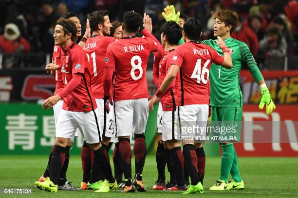 Urawa Red Diamonds' players celebrate their victory during the AFC Champions League group F football match between Japan's Urawa Red Diamonds and...