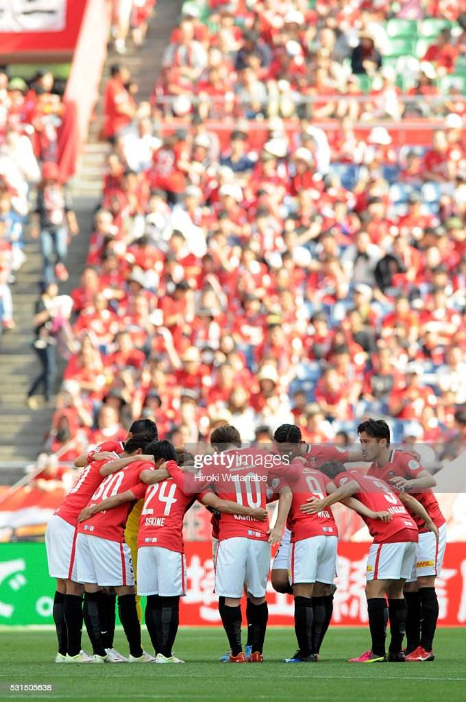 Urawa Red Diamonds players huddle prior to the J.League match between Urawa Red Diamonds and Albirex Niigata at the Saitama Stadium on May 14, 2016 in Saitama, Japan.