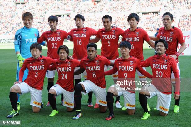 Urawa Red Diamonds players line up for the team photos prior to the JLeague J1 match between Urawa Red Diamonds and Cerezo Osaka at Saitama Stadium...
