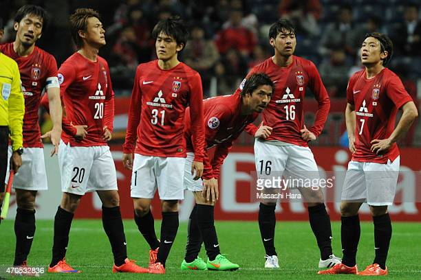 Urawa Red Diamonds players look on after the AFC Champions League Group G match between Urawa Red Diamonds and Suwon Samsung FC at Saitama Stadium on...
