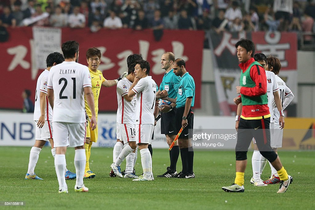 Urawa Red Diamonds players react after a penalty shootout during the AFC Champions League Round Of 16 match between FC Seoul and Urawa Red Diamonds at Seoul World Cup Stadium on May 25, 2016 in Seoul, South Korea.