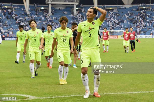 Urawa Red Diamonds players react after the 11 draw in the AFC Champions League Final 2017 first leg between AlHilal and Urawa Red Diamonds at King...