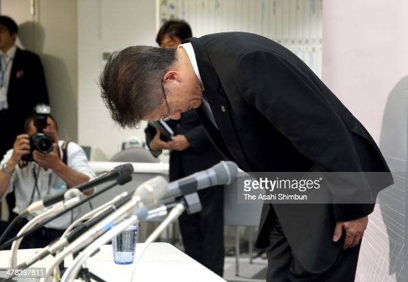 Urawa Red Diamonds President Keizo Fuchita bows for apology during a press conference at the JFA House on March 13 2014 in Tokyo Japan Urawa Red...