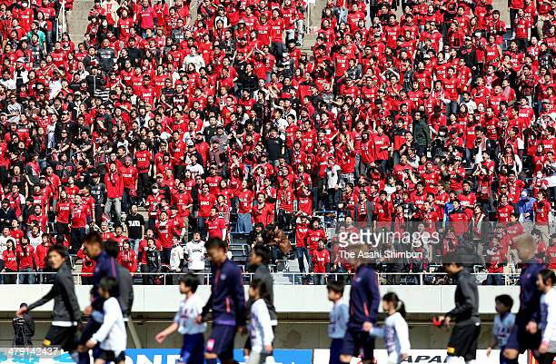 Urawa Red Diamonds supporters cheer during the JLeague match between Sanfrecce Hiroshima and Urawa Red Diamonds at Edion Stadium Hiroshima on March...