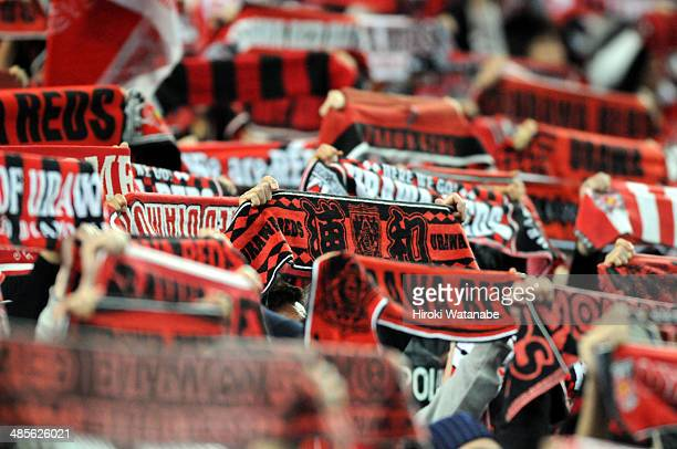 Urawa Red Diamonds supporters cheer during the JLeague match between Urawa Red Diamonds and Kawasaki Frontale at Saitama Stadium on April 19 2014 in...