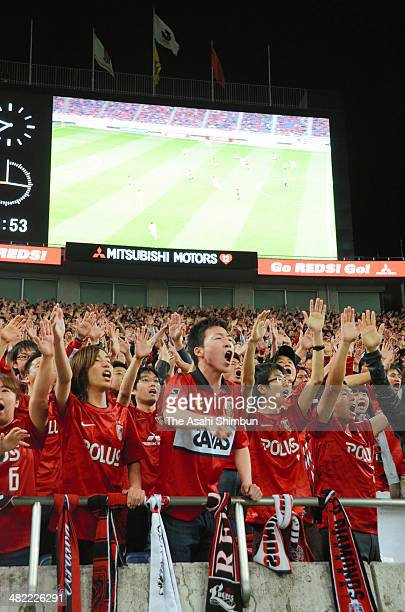 Urawa Red Diamonds supporters cheer during the JLeague Yamazaki Nabisco Cup match between Urawa Red Diamonds and Omiya Ardija at Saitama Stadium on...