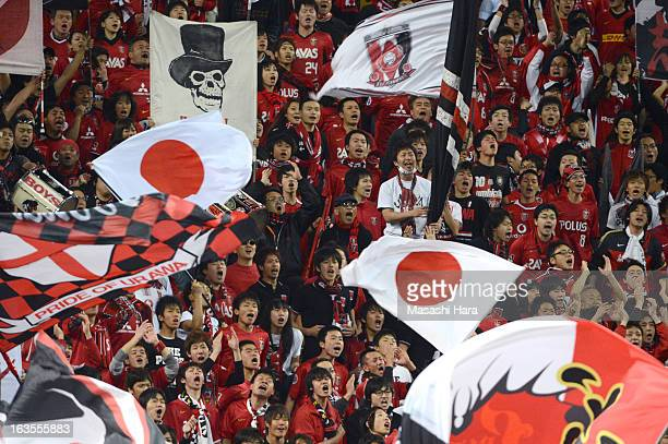 Urawa Red Diamonds supporters cheer prior to the AFC Champions League Group F match between Urawa Red Diamonds and Muangthong United at Saitama...