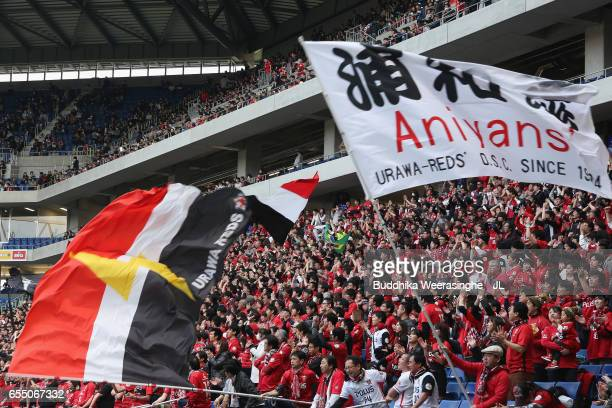 Urawa Red Diamonds supporters cheer prior to the JLeague J1 match between Gamba Osaka and Urawa Red Diamonds at Suita City Football Stadium on March...