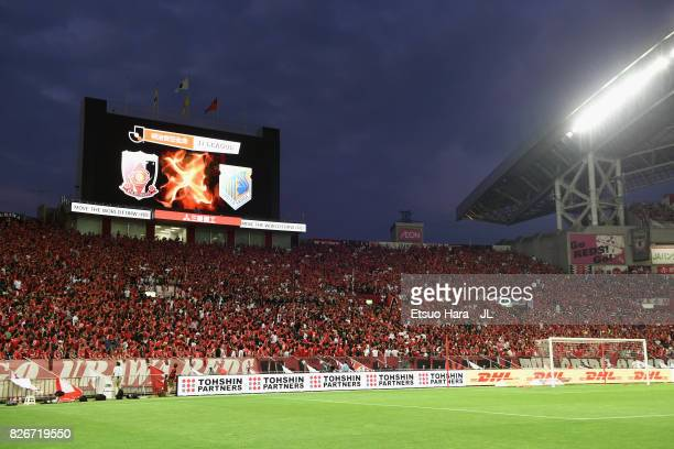 Urawa Red Diamonds supporters cheer prior to the JLeague J1 match between Urawa Red Diamonds and Omiya Ardija at Saitama Stadium on August 5 2017 in...
