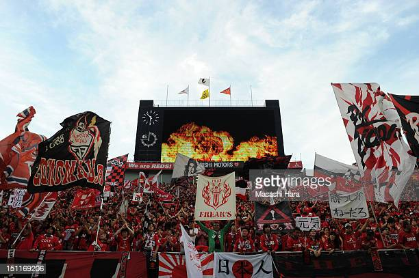 Urawa Red Diamonds supporters cheer prior to the JLeague match between Urawa Red Diamonds and Omiya Ardija at Saitama Stadium on September 1 2012 in...