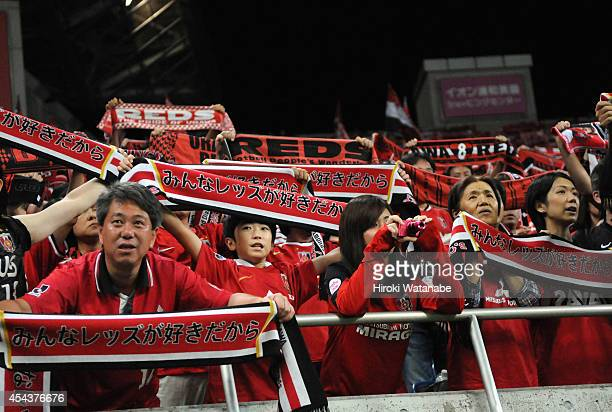 Urawa Red Diamonds supporters cheer prior to the JLeague match between Urawa Red Diamonds and Omiya Ardija at Saitama Stadium on August 30 2014 in...