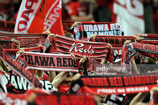 Urawa Red Diamonds supporters cheer prior to the JLeague match between Urawa Red Diamonds and Shonan Bellmare at Saitama Stadim on August 16 2015 in...