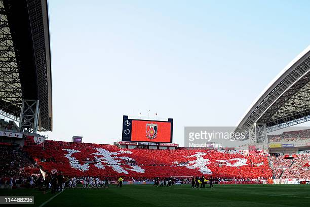 Urawa Red Diamonds supporters form the 'Urawa' characteres prior to the JLeague match between Urawa Red Diamonds and Kashima Antlers at Saitama...