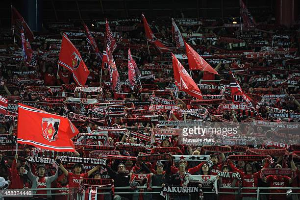 Urawa Red Diamonds supporters hold a mufflers after the JLeague match between Yokohama FMarinos and Urawa Red Diamonds at Nissan Stadium on November...