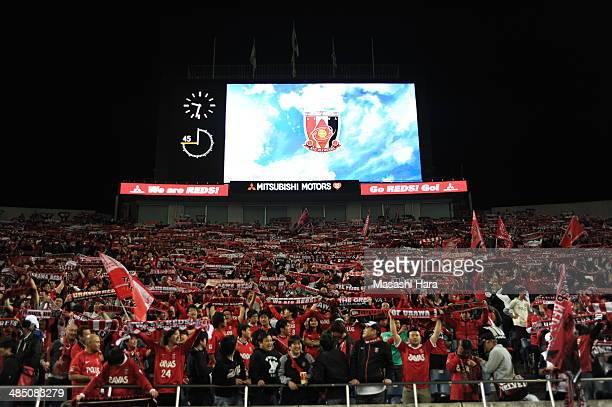 Urawa Red Diamonds supporters hold mufflers after the JLeague Yamazaki Nabisco Cup match between Urawa Red Diamonds v Tokushima Voltis at the Saitama...