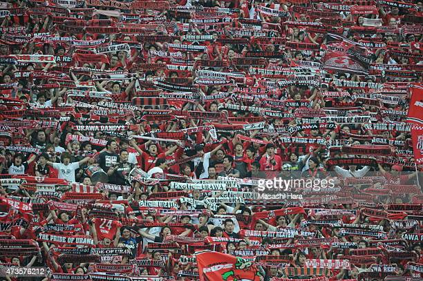Urawa Red Diamonds supporters hold mufflers after the JLeague match between Urawa Red Diamonds and FC Tokyo at Saitama Stadium on May 16 2015 in...