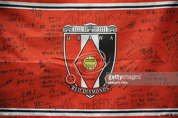 Urawa Red Diamonds supporters messages on flag during the JLeague match between Urawa Red Diamonds and Yokohama FMarinos at Saitama Stadium on May 3...