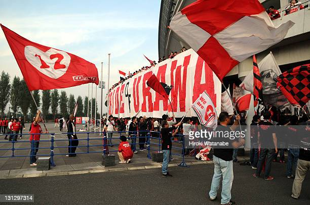 Urawa Red Diamonds supporters wave flags prior to the JLeague match between Urawa Red Diamonds and Jubilo Iwata at Saitama Stadium on November 3 2011...