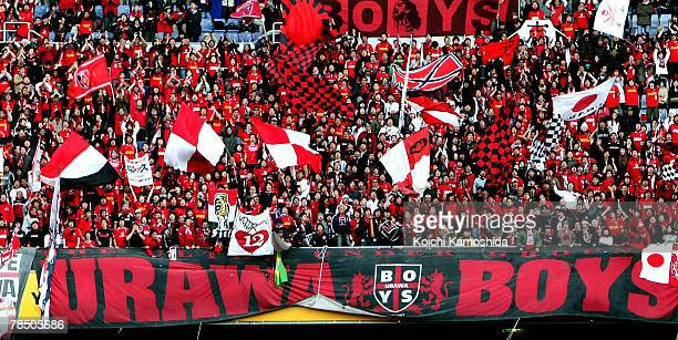 Urawa Red Diamonds supporters wave their flags during the FIFA Club World Cup match for third place between Etoile Sportive du Sahel and Urawa Red...