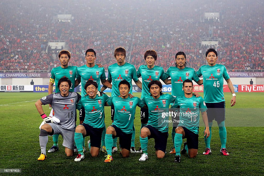 Urawa Red Diamonds team line up before the AFC Champions League Group F match between Guangzhou Evergrande and Urawa Red Diamonds at Tianhe Stadium on February 26, 2013 in Guangzhou, China.