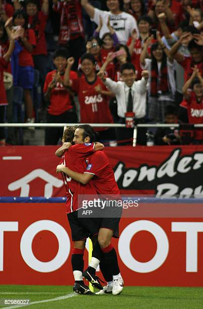 Urawa Reds defender Marcus Tulio Tanaka of Japan hugs his teammate midfielder Takahito Soma after scoring in their second leg Asian Champion League...