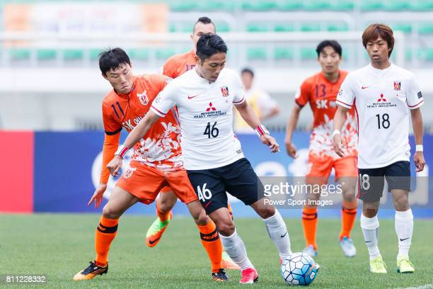 Urawa Reds Defender Moriwaki Ryota fights for the ball with Jeju United Forward Hwang Ilsu during the AFC Champions League 2017 Round of 16 match...