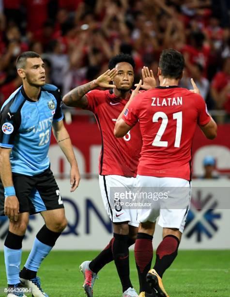 Urawa Reds forward Rafael Da Silva celebrates his goal with teammate Zlatan beside Kawasaki Frontale defender Eduardo during the AFC Champions League...