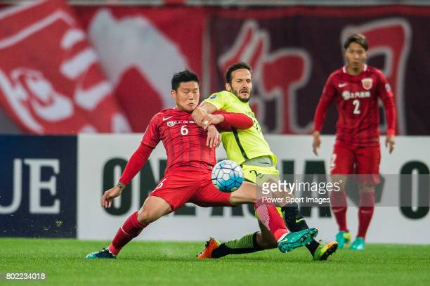 Urawa Reds Forward Zlatan Ljubijankic fights for the ball with Shanghai FC Midfielder Cai Huikang during the AFC Champions League 2017 Group F match...