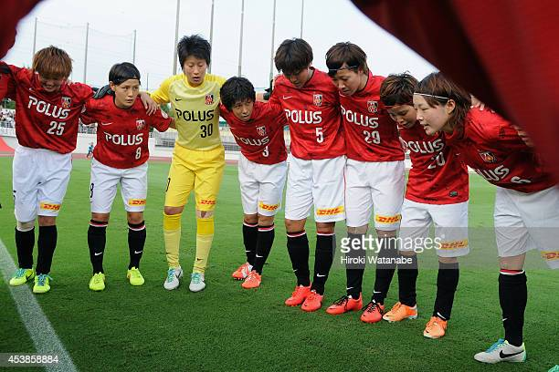 Urawa Reds Ladies players form a huddle prior to the Nadeshiko League match between Urawa Red Diamonds Ladies and INAC Kobe Leonessa at Komaba...