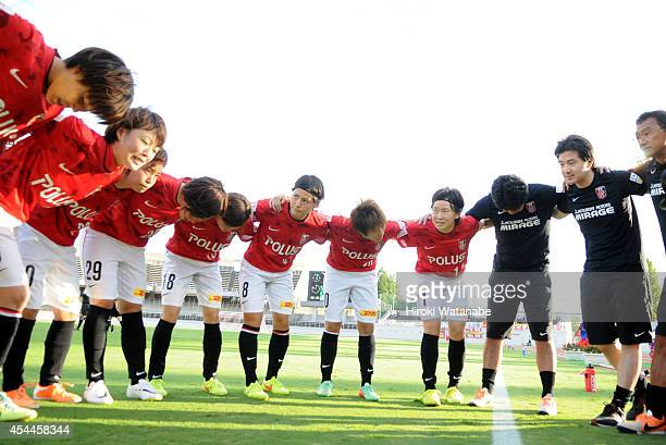 Urawa Reds Ladies players form a huddle prior to the Nadeshiko League Exciting Series match between Urawa Red Diamonds Ladies and INAC Kobe Leonessa...