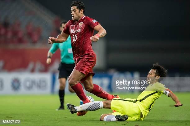 Urawa Reds Midfielder Abe Yuki trips up with Shanghai FC Forward Givanildo Vieira De Sousa during the AFC Champions League 2017 SemiFinals match...