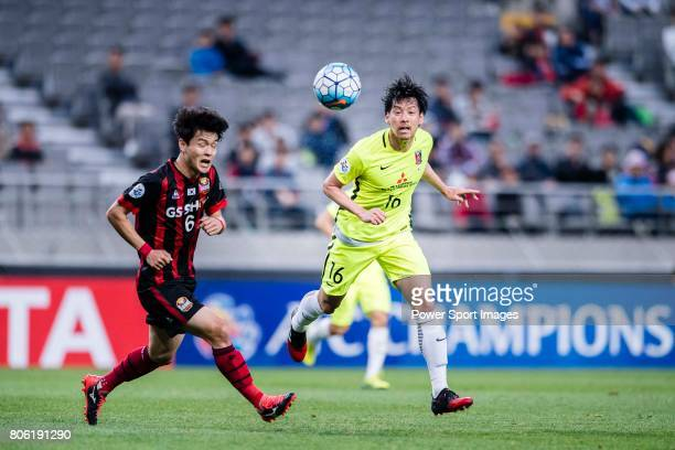Urawa Reds Midfielder Aoki Takuya fights for the ball with FC Seoul Midfielder Ju Se Jong during the AFC Champions League 2017 Group F match between...