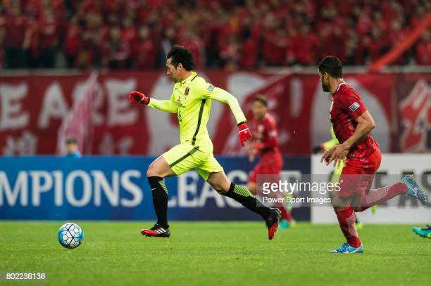 Urawa Reds Midfielder Aoki Takuya in action during the AFC Champions League 2017 Group F match between Shanghai SIPG FC vs Urawa Red Diamonds at the...