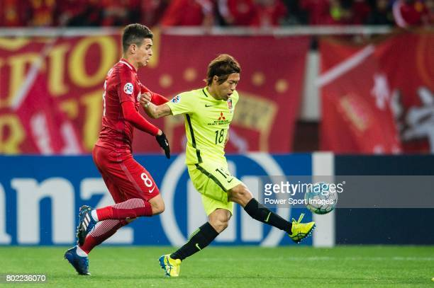 Urawa Reds Midfielder Komai Yoshiaki in action against Shanghai FC Forward Oscar Emboaba Junior during the AFC Champions League 2017 Group F match...