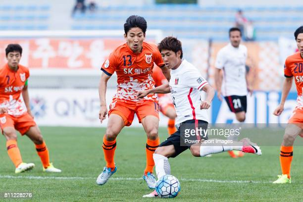 Urawa Reds Midfielder Sekine Takahiro in action against Jeju United Defender Chung Woon during the AFC Champions League 2017 Round of 16 match...