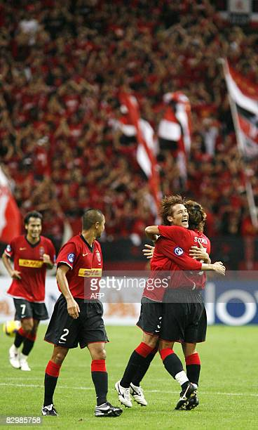 Urawa Reds midfielder Takahito Soma of Japan hugs with his teammate Hajime Hosogai after scoring against Kuwait during their second leg Asian...