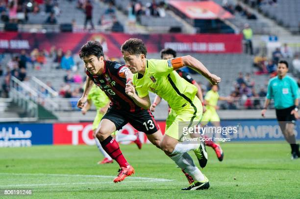 Urawa Reds Midfielder Ugajin Tomoya fights for the ball with FC Seoul Midfielder Go Yohan during the AFC Champions League 2017 Group F match between...