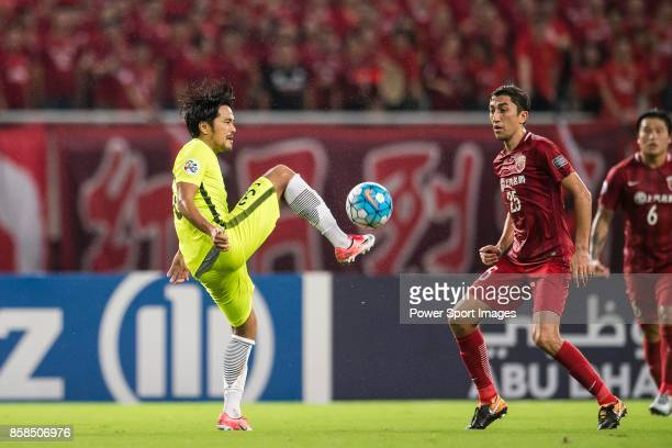 Urawa Reds Midfielder Ugajin Tomoya fights for the ball with Shanghai FC Midfielder Akhmedov Odil during the AFC Champions League 2017 SemiFinals...