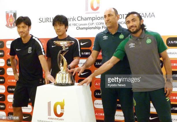 Urawa Reds midfielder Yuki Abe manager Takafumi Hori Chapecoense manager Vinicius Eutropio and defender Apodi pose for a photo at Saitama Stadium in...