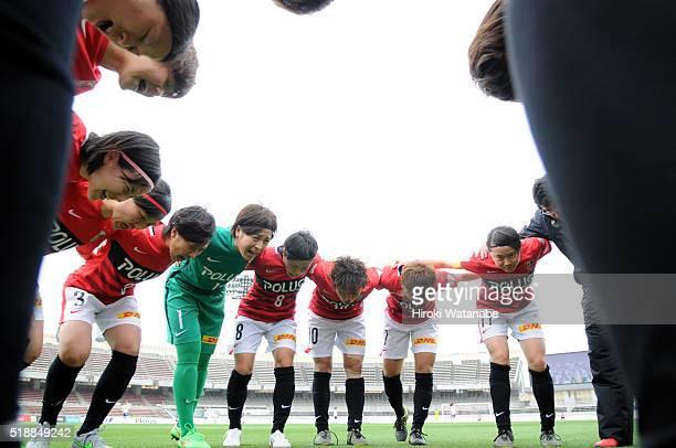 Urawa Reds players form a huddle prior to the Nadeshiko League match between Urawa Red Diamonds Ladies and Albirex Niigata Ladies at the Saitama...