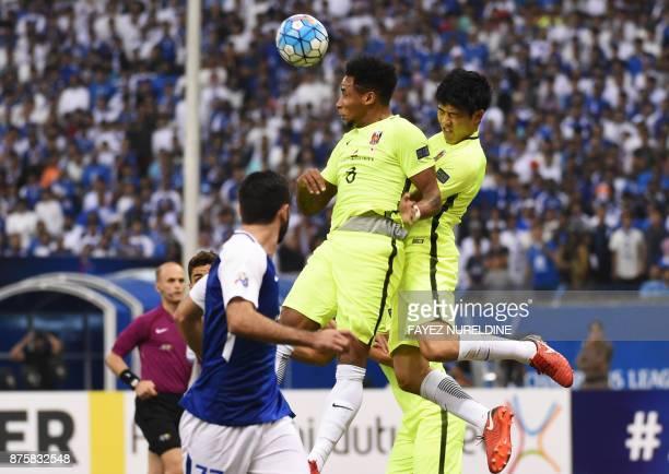 Urawa Reds' Rafael da Silva heads the ball during the Asian Champions League final football match between Saudi Arabia's AlHilal and Japan's Urawa...