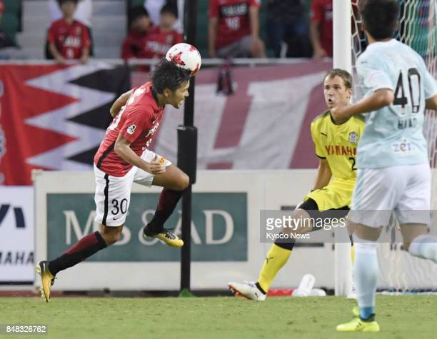 Urawa Reds' Shinzo Koroki heads an equalizer during the second half of a 11 draw with Jubilo Iwata in the JLeague first division at ECOPA Stadium in...