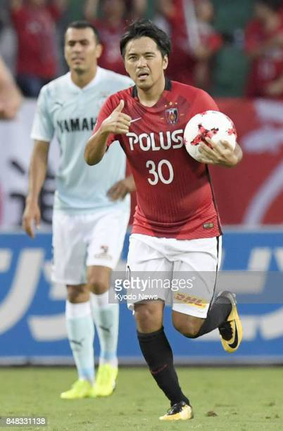 Urawa Reds' Shinzo Koroki reacts after scoring an equalizer during the second half of a 11 draw with Jubilo Iwata in the JLeague first division at...