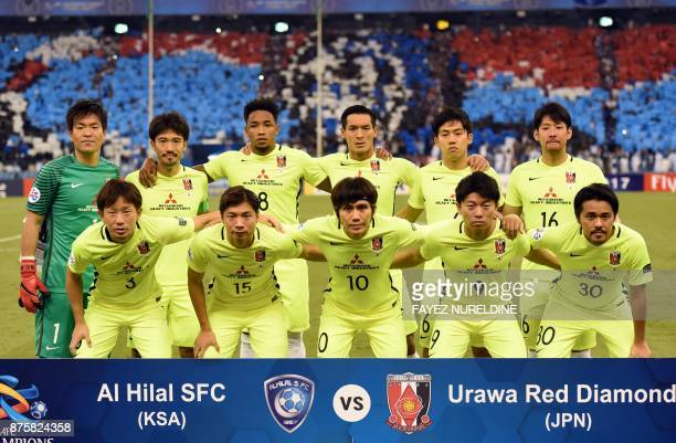 Urawa Reds' starting eleven pose for a group picture ahead of the Asian Champions League final football match between Japan's Urawa Reds and Saudi...