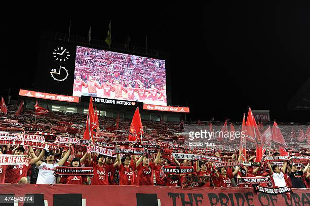 Urawa Reds supporters celebrate their 21 win in the JLeague match between Urawa Red Diamonds and Kashima Antleres at Saitama Stadium on May 23 2015...